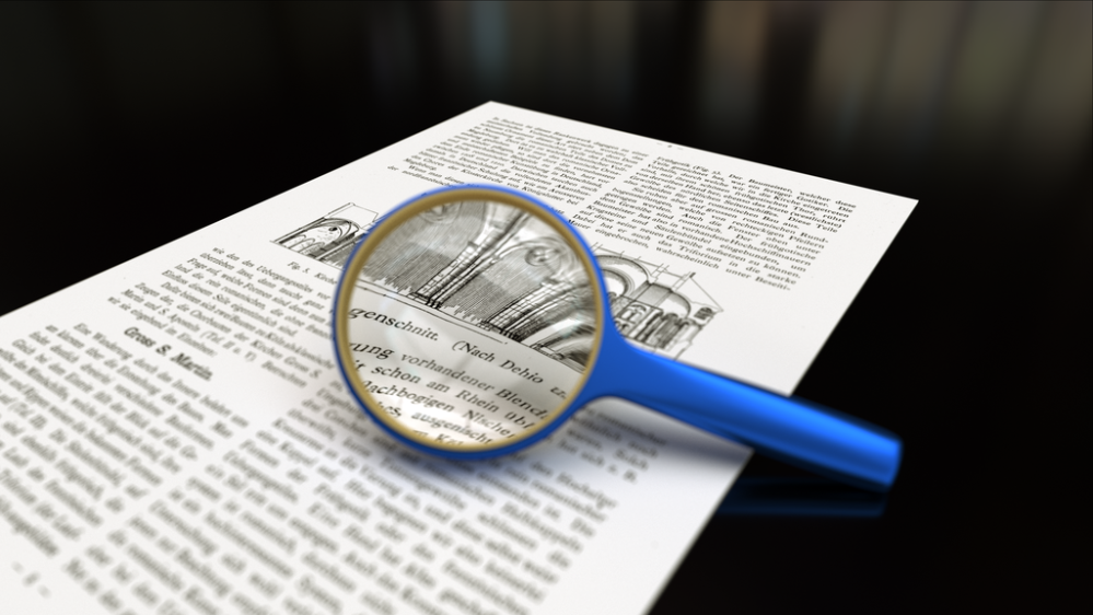 https://commons.wikimedia.org/wiki/File:Magnifying_glass_with_focus_on_paper.png